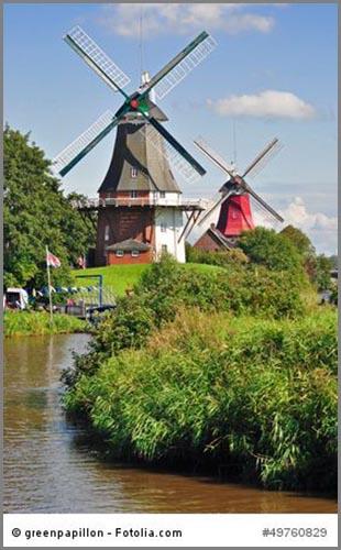 Nutzung der Windkraft früher: Windmühlen pumpen Wasser in Holland